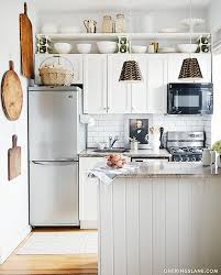 small kitchen refrigerator. Kitschy Country Accessories Give This Compact Kitchen An Eclectic Pastoral Vibe, But The Foundations Of It\u2014subway Tile, Granite Counters, Small Refrigerator I
