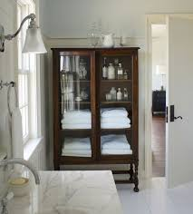 i love the look of a wood cabinet in a washroom it adds such a bathroom furniture ideas