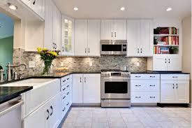 white kitchen cabinets with dark granite counters