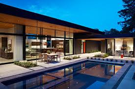 view in gallery large glass walls connect the interior with the rear yard and the pool