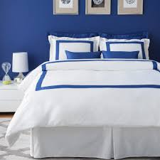 appealing bedroom decorating ideas with royal blue wall color paint and royal blue white bed sheet