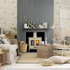 Panel behind the TV, in the same gray as the fireplace up to the ceiling.  Then find a nice subtle, yet designer wall paper for the left & right side,  ...