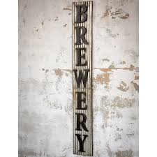 large corrugated distressed metal brewery sign