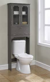cabinets over toilet in bathroom. features: -elegant etagere with 2 glass doors, 1 adjustable shelf, flip down open door, chrome hardware. -fits over the toilet to maximize your storage cabinets in bathroom e