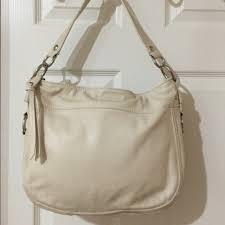 Coach F14707 Ivory Leather Shoulder Bag Rivets. Silver hardware. Zip  closure. 3 interior pockets (1 zips). Bag is dirty. Interior is clean.
