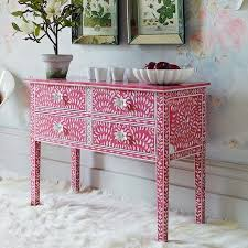 Rich hued upholstery , intricate mosaic or terra cotta tiles are present  throught Moroccan decor. Mother of pearl inlay is a pleasure to look at!!