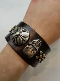 skull and shield studded leather bracelet dark brown