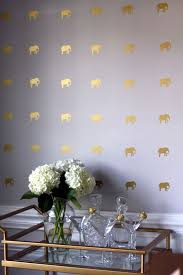 this combination of white and gold is awesome and wall pattern of elephants simply looks alluring to the eyes diy wallpaper 7