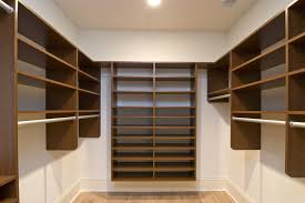 walk in closet with basic storage for shoes and clothes racks