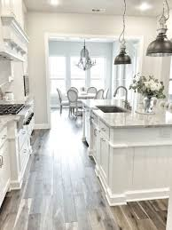 Wood Floors In Kitchen With White Cabinets As Well Flooring And