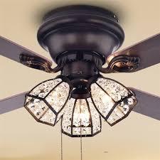 warehouse of tiffany tarudor 3 light 4 blade 42 in ceiling fan lowe s canada