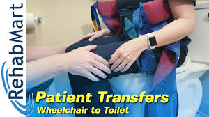 using a hoyer patient lift to transfer a patient from wheelchair to toilet