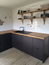 ikea kitchen cabinet s unique i like the wood counter and black cabinet but id put