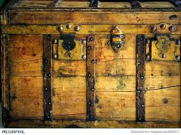 old wooden chest trunk in golden color