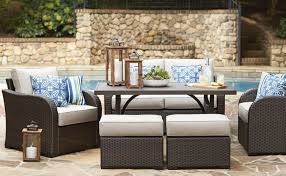 patio furniture. Simple Furniture Image Of Northborough Patio Set In A Poolside Area With Hurricane Lanterns  And Serving Tray In Patio Furniture O