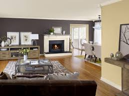 interior living room with brown sofa and wooden floor also neutral best color to paint a