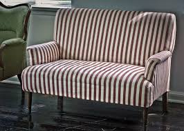 Vintage sofa from a old Danish home Red and white stripes Stock