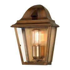 light flush fitting in solid antique brass