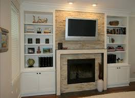 stone fireplace with tv stand and built in cabinet made from white stained wood as well bookshelves around plans also custom cabinets ins round designs