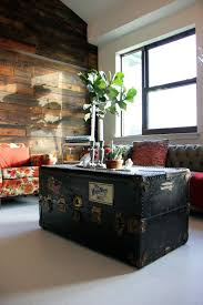 view in gallery old trunk complete with stickers used as coffee table