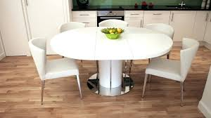 bright and modern round pedestal extending dining table white gloss base chairs wood oak ex