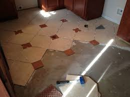 we decided to install a combination of laminate flooring and ceramic tile
