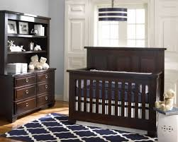 love this nursery the rug the light fixture the colors in dark brown nursery furniture