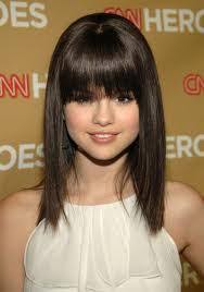 im looking for a new hairstyle and i absolutey love selena gomez hairstyle post a picture of her with sort hair