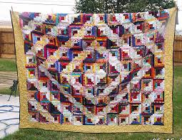 Log Cabin Quilts Photo Gallery and Layout Tips & Scrappy Log Cabin Quilt for Matt Adamdwight.com
