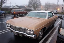 OLD PARKED CARS.: 1970 Chevrolet Impala 4-door hardtop.