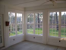Remodel project - Sun Porch turned into Sunroom/Sun Porch. Beautiful wall  of windows