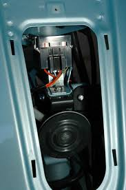 modern vespa lx150 installing a 12v power outlet using a 3 or preferably 4 large phillips screwdriver remove the top two screws under the horn cover these hold the top of the glove box legshield