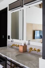 hotel bathroom fixtures. Carrara Marble Top Rests On A Steel Base That Was Inspired By The Balconies Of Bauhaus In Dessau, Germany. Cross-handled Faucets Are Unlacquered Hotel Bathroom Fixtures L
