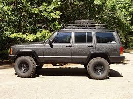 here s another shot of a jeep cherokee with a bedliner paintjob this jeep is obviously intended for offroad duty and the bed liner will protect it from