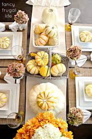 Fall Table--White plates, pumpkin and gourds in baskets, cream ruffle table