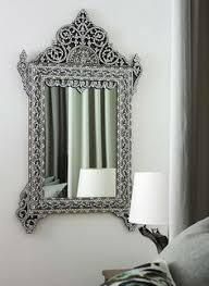 a syrian mirror inlaid with mother of pearl and bone is a focal point in the bedroom bedroommarvellous office chairs bones furniture company