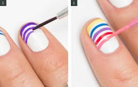 continue painting diffe colored stripes on the tips of the last three remaining nails paint your middle finger with a cobalt blue like sally hansen i