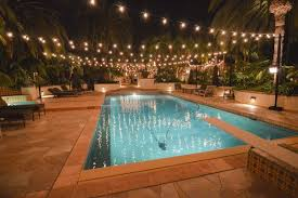 swimming pool lighting options. string lights in the backyard over pool will help with night time ambiance i would attach them from roofline to fence on other siu2026 swimming lighting options