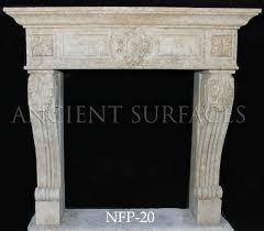 a tudor style limestone fireplace mantel