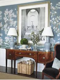 grey blue gracie wallpaper an antique english sideboard lovely millwork and mouldings grey velvet upholstered bergere and a black and white