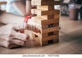 How To Play Tumbling Tower Wooden Block Game Tumbling Tower Fun Addictive Game Witty Stock Photo 100 89