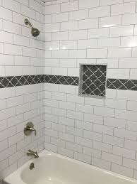 large white subway tile with dark gray grout and gray fleur accent how to clean bathroom