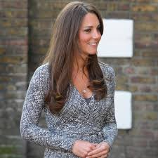 Wearing a white and navy diane von furstenberg cotton wrap dress and her trademark wedges, the duchess of cambridge arrived in winmalee in new south wales to meet with rescue. Pictures Of Pregnant Kate Middleton In Wrap Dress Popsugar Family