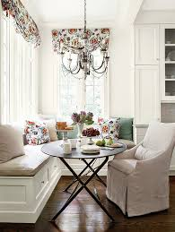 complement a round kitchen table with a chandelier