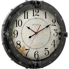 w round metal wall clock with maritime