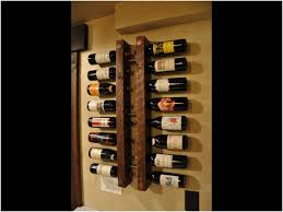 a beautiful wine rack made from reclaimed wood iron pipes made for 16 bottles high
