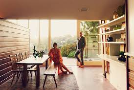 Trina Turk and her husband, Jonathan Skow, inside a Los Angeles home they  restored. It was designed by the midcentury architect John Lautner.