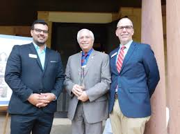 travis owens preservation oklahoma board member and cnb director of cultural tourism alongside cherokee nation prinl chief bill john baker and