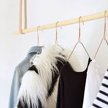 Build this minimal leather and wood hanging rail in less than 30 minutes! Hanging  RailDiy HangingHanging Clothes ...