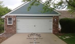 Carriage House garage door No windows Denver Garage Door Repair